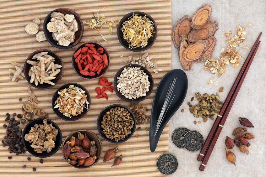 53799169 - acupuncture needles, traditional chinese herbs for herbal medicine, i ching coins and chopsticks.